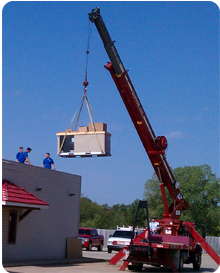 A crane is often used to set commercial rooftop HVAC units in Shawnee, Ok